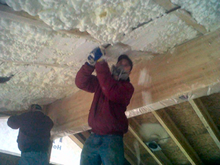 open-cell-being-cut-flush-after-sprayed-in-ceiling